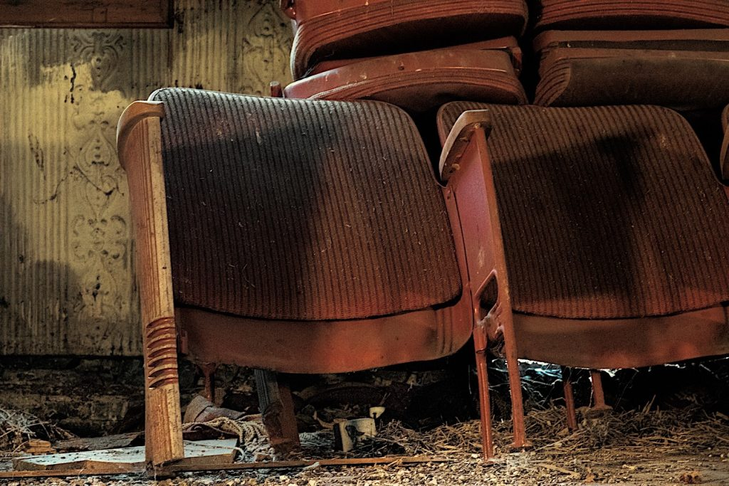 Old seats piled on stage